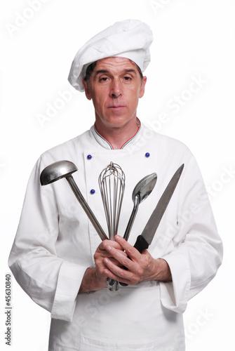 Cocinero chef sujetando utensilios de cocina cocinando for Utensilios de chef