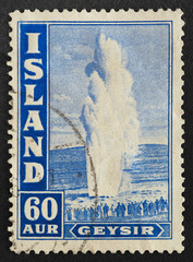 Mail stamp printed in Iceland featuring a geyser, circa 1938