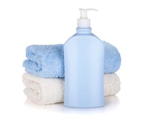 Shampoo bottle and towels