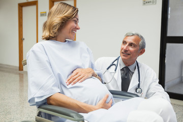 Doctor is talking to a pregnant woman