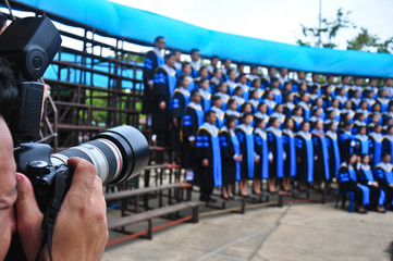 taking a picture for asia graduation