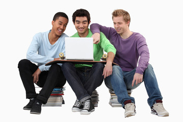 Young men looking at a laptop