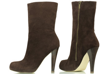 Dark brown high-heeled boots on a white background