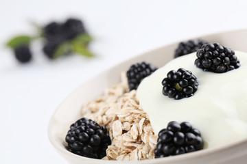 Oatmeal with yogurt and fresh organic blackberries