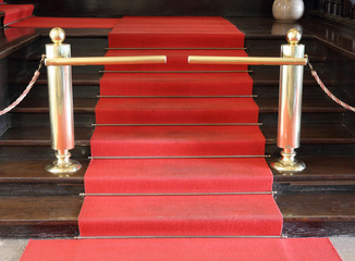 Red security rope by red carpet.