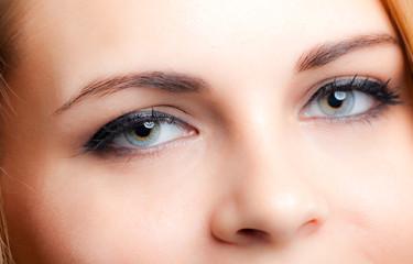 Closeup of woman blue eyes