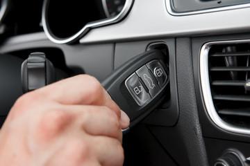 Hand inserting hightech car key