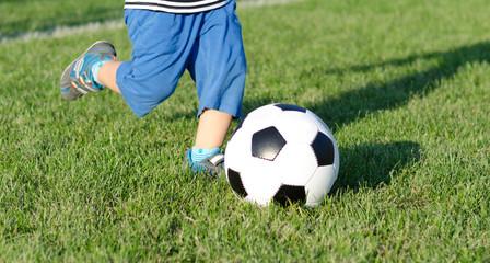 Child kicking a soccer ball
