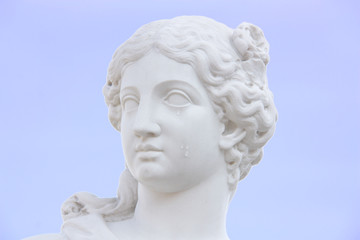 beatiful woman white marble statue face with tears on a cheek