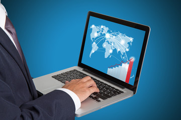 businessman working with laptop and business graph