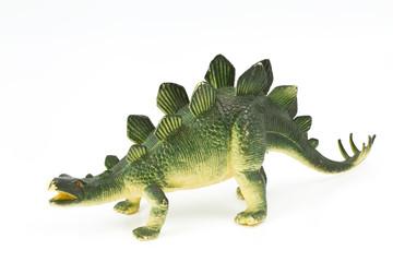 Toy plastic dinosaur on white baclground