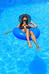 a girl in bikini is in the water
