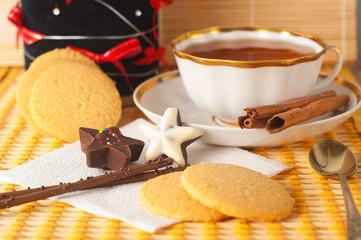 Christmas tea with cinnamon and cakes