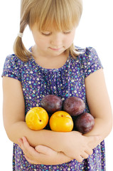 Girl holding plums on the isolated background