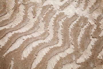 Abstract designs pattern of wet coastal sand