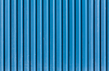 Vertical ridged blue painted metal wall texture