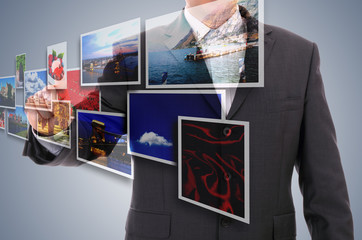 businessman choosing one of 3d streaming images