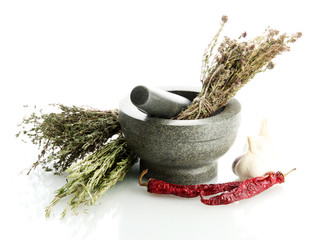 dried herbs in mortar and vegetables, isolatrd on white
