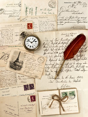 letters and post cards with vintage clock