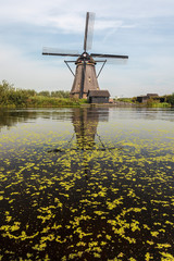 A traditional Dutch windmill in Kinderdijk Holland