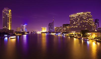 City and the river in the night time.
