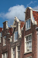 Facades of historical Amsterdam canal houses