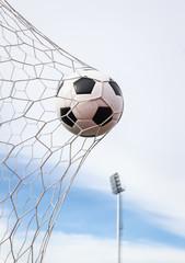 Fototapeta football in the goal net