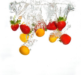 Strawberries and oranges falling