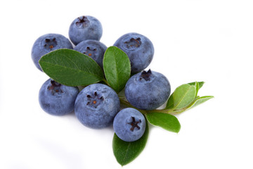 fresh blueberry with leaves isolated on white background.