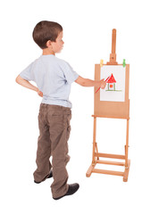 boy paints house on easel