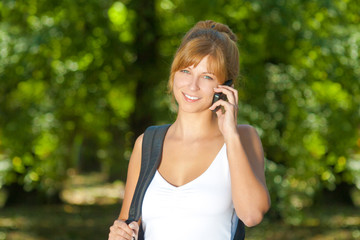 Beautiful girl talking on the cell phone