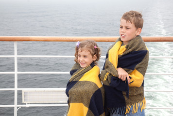 brother and sister in plaid travel on ship