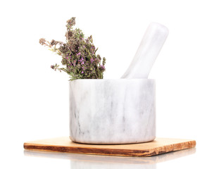 Thyme herb and mortar isolated on white