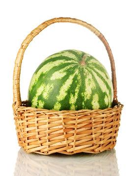Ripe watermelon in wicker basket isolated on white