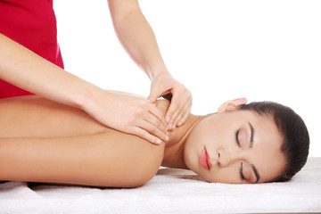 Pretty young woman relaxing being massaged