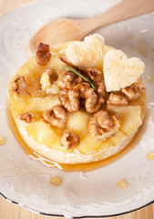 Baked Camembert  with honey, toast, rosemary and nuts