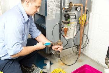 Plumber repaires furnace