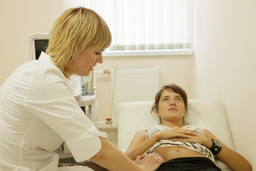 Woman doctor examining the patient