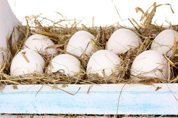 eco-friendly eggs in wooden box close-up
