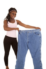 woman holding huge pants