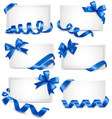 Set of gift card notes with blue bows with ribbons