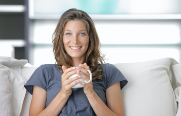 Cute young lady with a cup of coffee