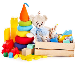 Children toys with teddy bear and cubes.
