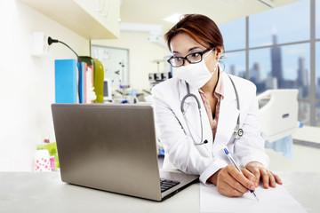 Doctor copy prescription from laptop