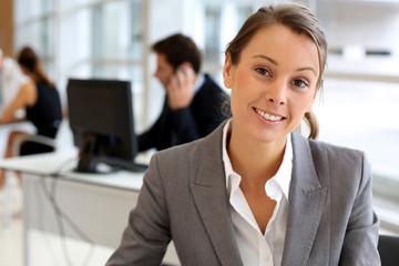 Portrait of attractive businesswoman sitting in office