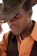 African cowboy serious orange shirt