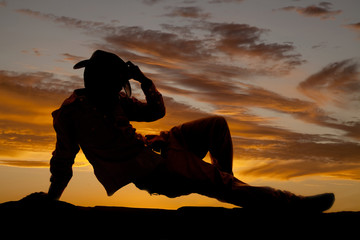 cowboy on ground hold hat silhouette