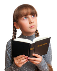girl reading a  Bible