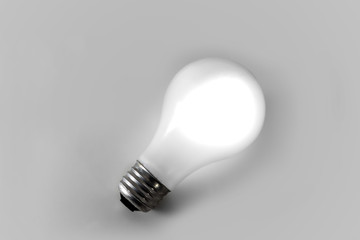 White Incandescent Light Bulb Isolated on White Backdrop