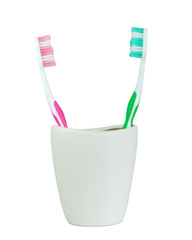 green and pink tooth brush split out